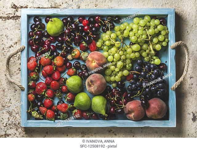 Healthy summer fruit variety - Black and green grapes, strawberries, figs, sweet cherries and peaches
