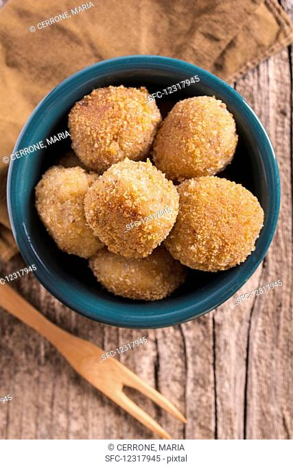 Vegetarian cauliflower balls in a bowl (top view)