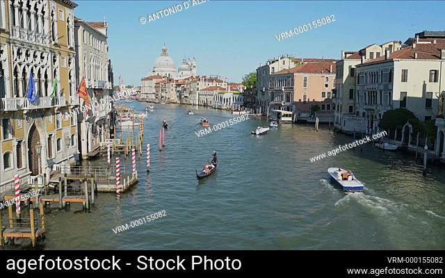 Nautical vessels sailing in Grand Canal on a calm evening. Venice. Italy