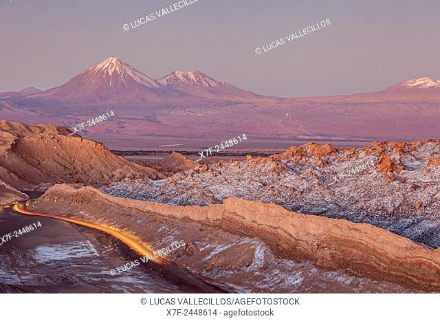 Valle de la Luna (Valley of the Moon ), in background at left volcanoes Licancabur and Juriques with snow on top, and salt deposited on the nearest mountains