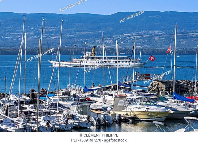 Swiss historic Belle Epoque paddle steamboat Savoie and sailing boats in the marina at Yvoire along Lake Geneva / lac Léman, Haute-Savoie, France