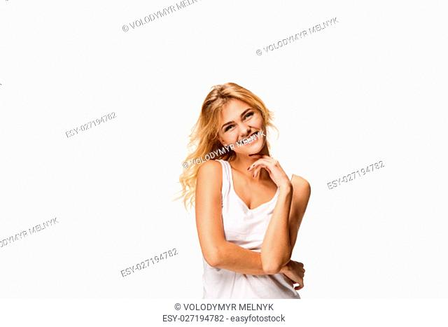 The young woman's portrait with happy emotions on white studio background