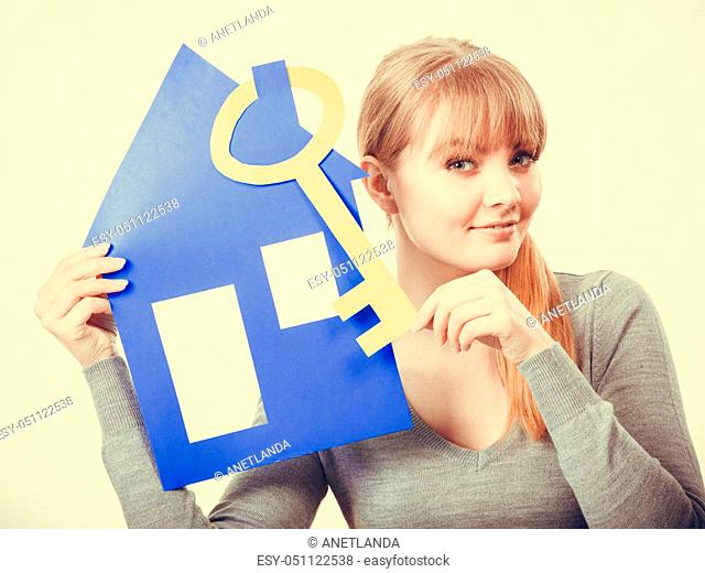 Selling and buying real estate concept. Young blonde smiling positive female estate agent ready to sell house home
