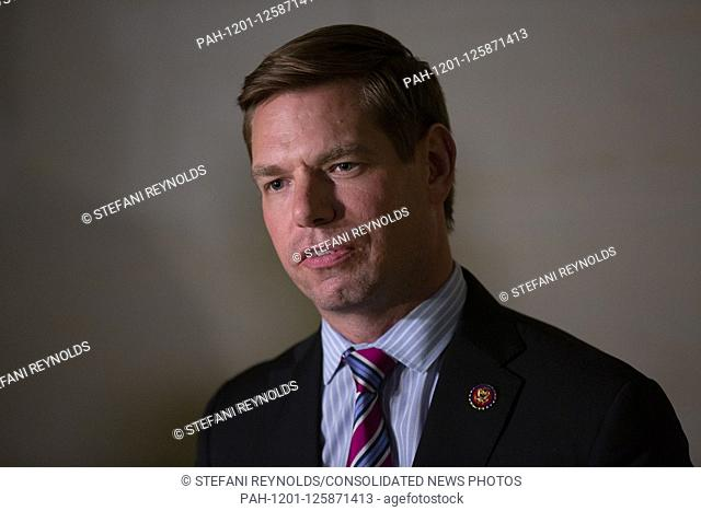 United States Representative Eric Swalwell (Democrat of California) speaks to the press as he departs the closed-door deposition of William Taylor, the acting U