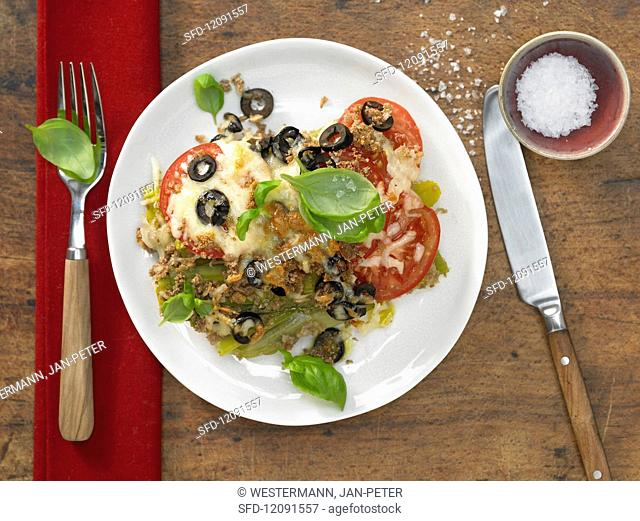 Leek and tomato gratin with olives and basil