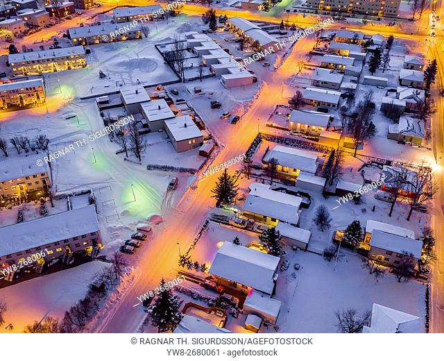 Aerial view- Street and homes in the winter, Akureyri, Iceland. This image is shot using a drone