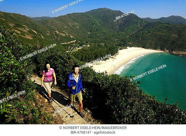 Hikers on the McLehose Trail overlooking Long Ke Beach, Sai Kung Peninsula, New Territories, Hong Kong, China