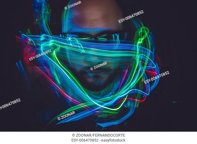 design effect lightpainting man with sunglasses and colored lights