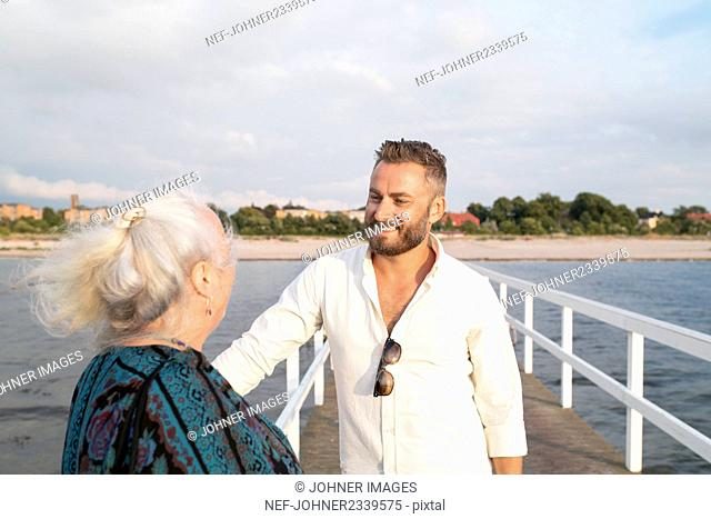 Man with senior mother at seaside