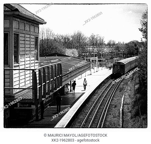 Train approaching to wimbledon park station, London, UK