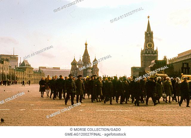 View facing southeast of a large crowd in Red Square, Moscow, Soviet Russia, USSR, November, 1973. At center background is Saint Basil's Cathedral