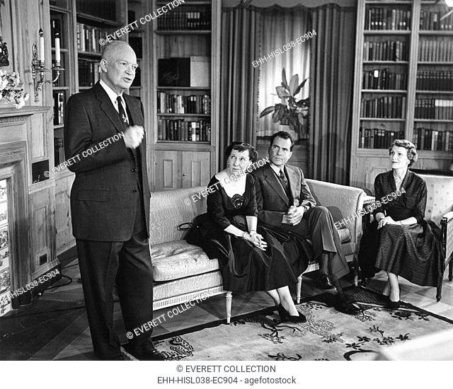 President Eisenhower speaking on election eve, Nov. 5, 1956. Seated are Mamie Eisenhower with Pat and Richard Nixon. - (BSLOC-2014-16-10)