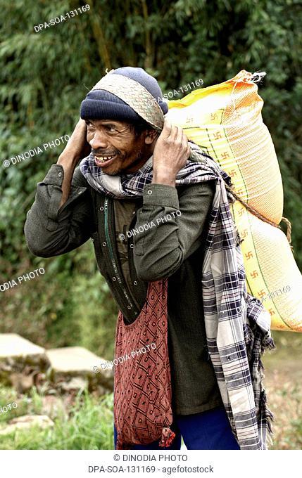 Rural man carrying load on his back ; the Khasi tribe  ; Shillong ; Meghalaya ; India