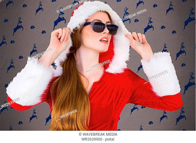 Beautiful woman in santa costume and sunglasses