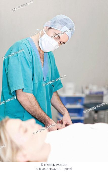 Doctor preparing patient for surgery