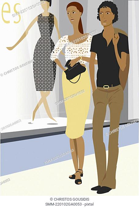 Young couple walking by store window