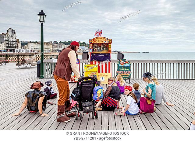 People Waiting For The Start Of A Traditional Punch and Judy Show On Hastings Pier, Hastings, Sussex, UK