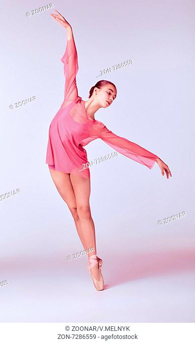 Young ballerina dancer showing her techniques