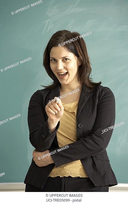 Teacher pointing at class