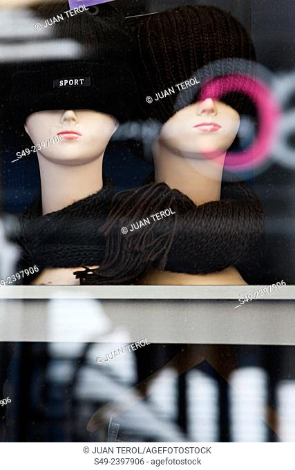 Two mannequins with wool hats in a shop window, Valencia, Comunidad Valenciana, Spain