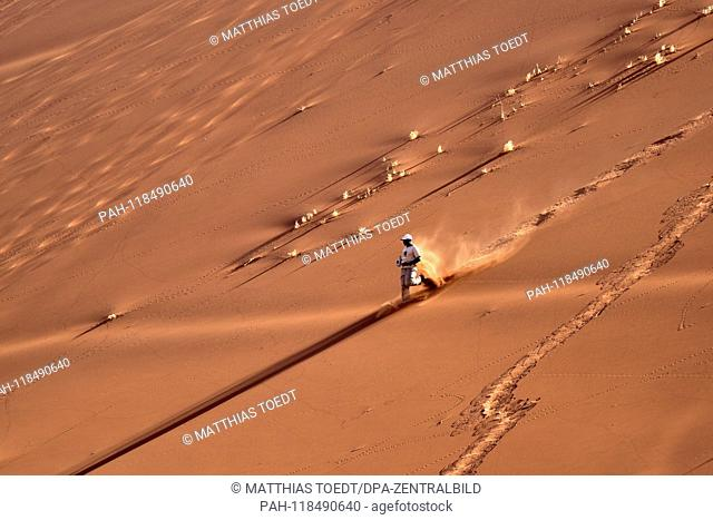 Visitors to the dunes around Dead Vlei are down a dune, taken on 01.03.2019. The Dead Vlei is a dry, surrounded by tall dune clay pan with numerous dead acacia...
