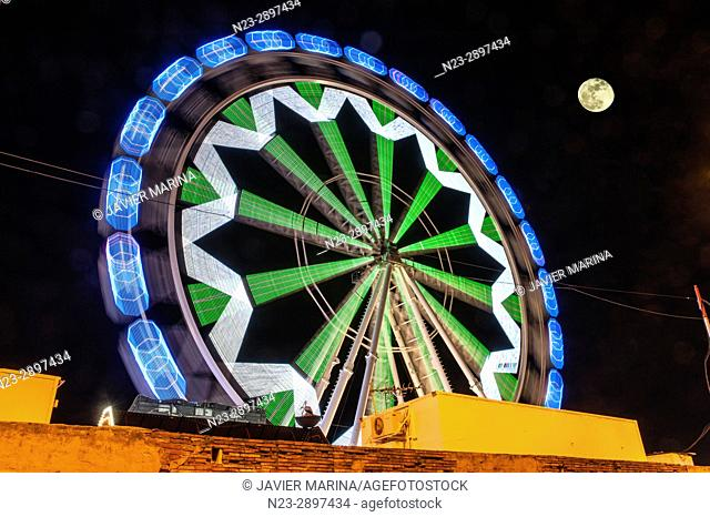 Ferris wheel and moon at the fair in Valencia, Valencian Community, Spain