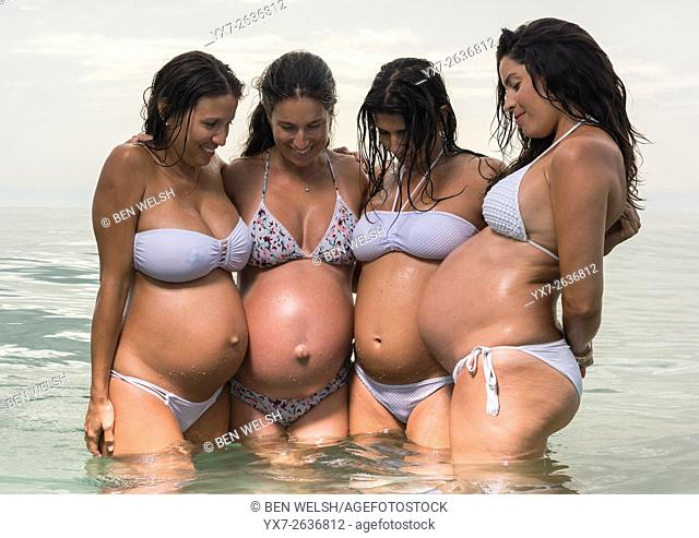 Pregnant women at the beach. Tarifa, Costa de la Luz, Cadiz, Andalusia, Southern Spain, Europe