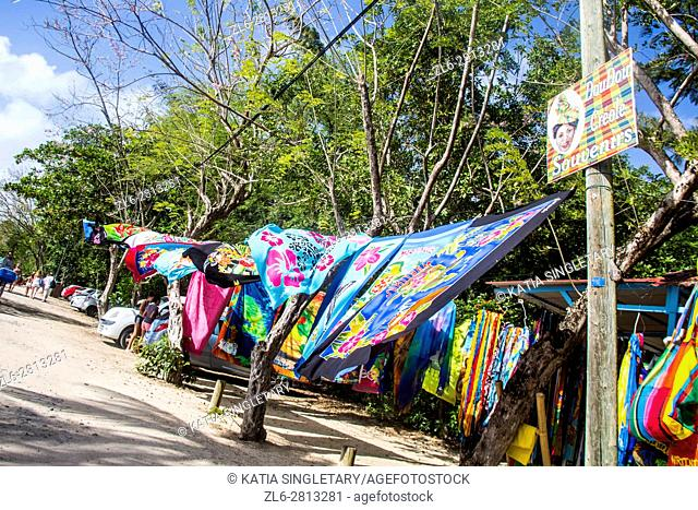 Walking around the beach Les Salines in Martinique. Typical Fabrics line up, hanged and for sale along all the little snack bars and restaurant