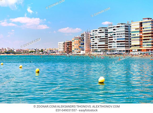 View to the high rise buildings and beach of Torrevieja at summertime. Costa Blanca. Spain