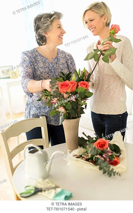 Two women arranging bouquet