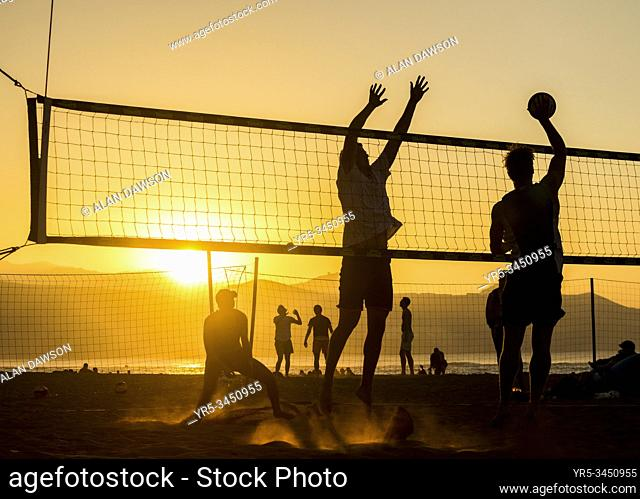Beach volleyball at sunset on Las Canteras beach in Las Palmas, Gran Canaria, Canary Islands, Spain
