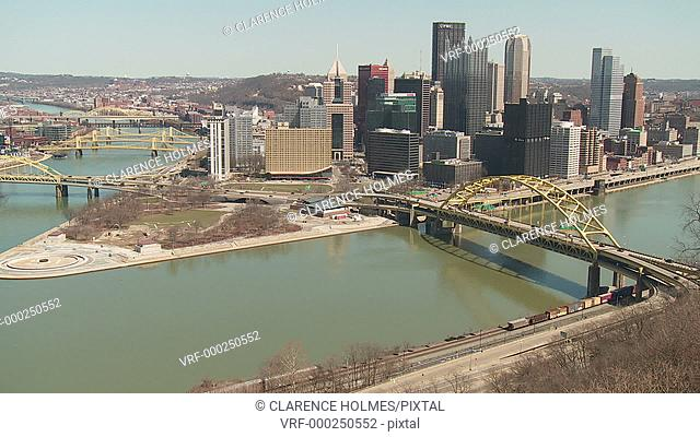 A view of the downtown area including the skyline, bridges, and Point State Park at the confluence of the Allegheny and Monongahela Rivers in Pittsburgh
