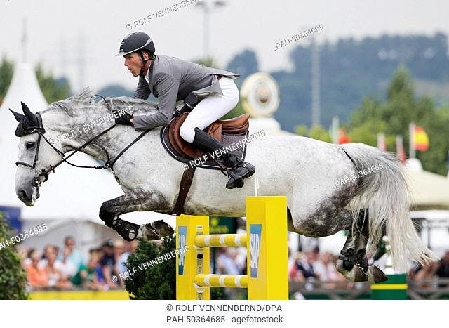 German rider Ludger Beerbaum on her horse Chiara 222 in action during the Grand Prix at the CHIO international horse show in Aachen, Germany, 20 July 2014