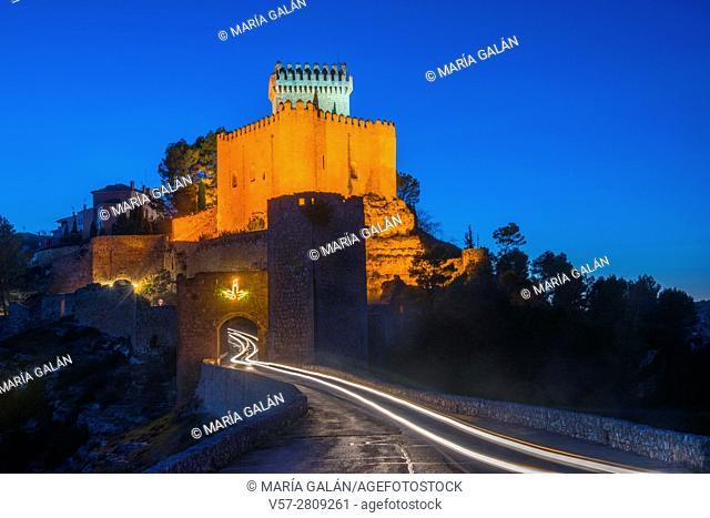 Castle and medieval gate, night view. Alarcon, Cuenca province, Castilla La Mancha, Spain