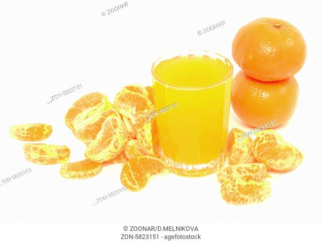 tangerine juice and segments of tangerine isolated on white