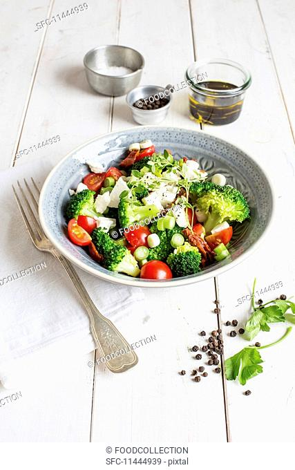 Broccoli salad with cherry tomatoes and mozzarella