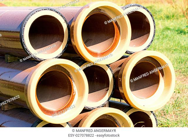 Stack of canalization pipes at a construction site