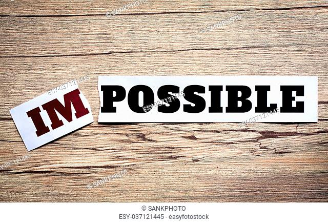 Word impossible transformed into possible. Motivation philosophy concept.Concepts of problem solving, overcoming challenges and success