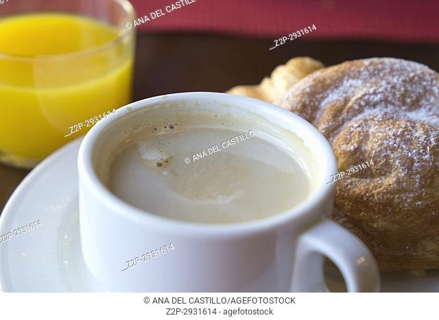Breakfast on table coffee with pastries and orange juice