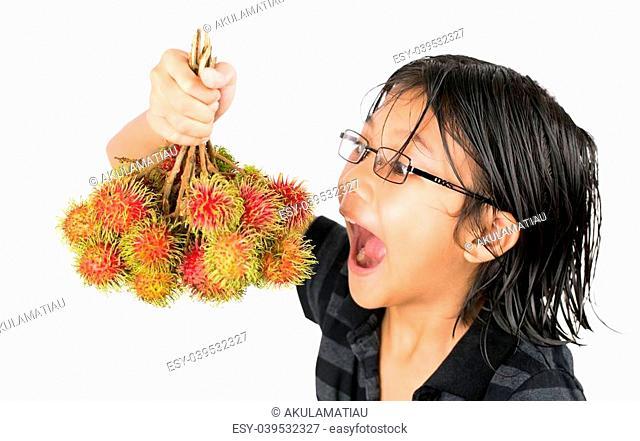A Malay Asian girl with a bunch of ripe rambutan