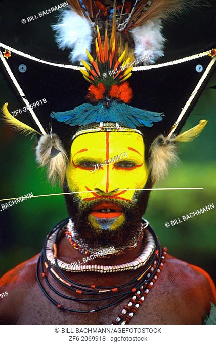 Colorful Huli Wigmen with Yellow Face In Papua New Guinea