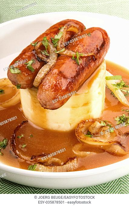 traditional irish dish banger and mash, bangers with mashed potatoes, sausages with grilled onions and gravy