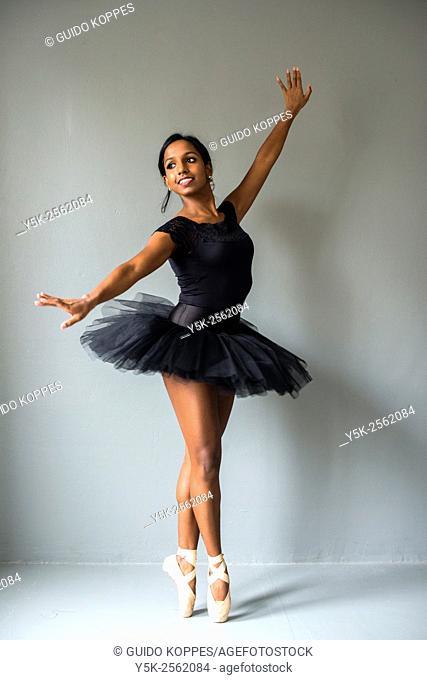 Tilburg, Netherland. Non caucausan female classical ballet dancer, studio shot