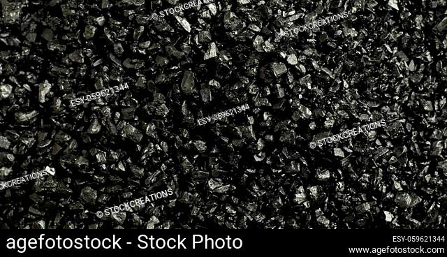 Panorama background texture of black Hawaiian Salt colored with volcanic activated charcoal in a full frame view showing the granulated crystals