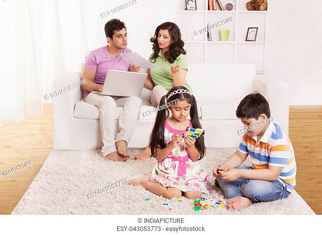 Parents looking at kids play