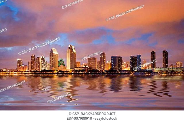 San Diego skyline at dusk reflected in sea