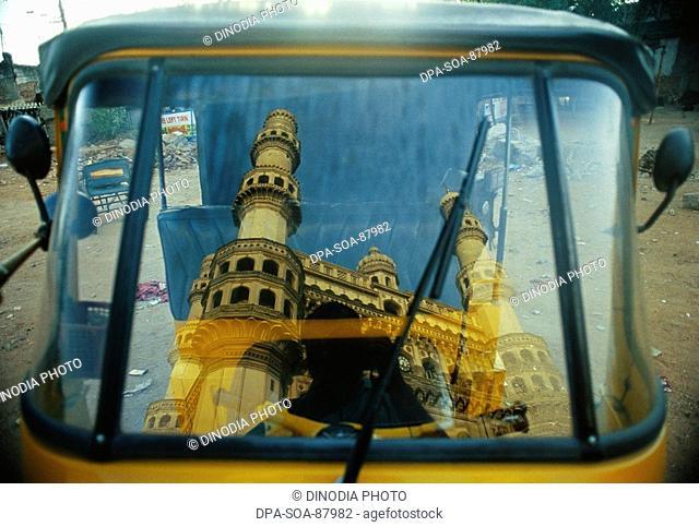Charminar reflection on rickshaw window , Hyderabad , Andhra Pradesh , India