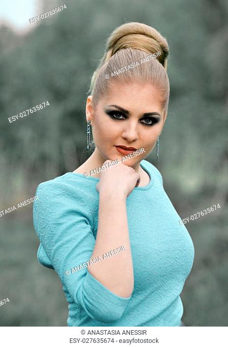Glamour girl with cute smile.Close-up portrait of beautiful nice pretty fashionable glamorous adorable interesting girl,model with smokey eyes,creative