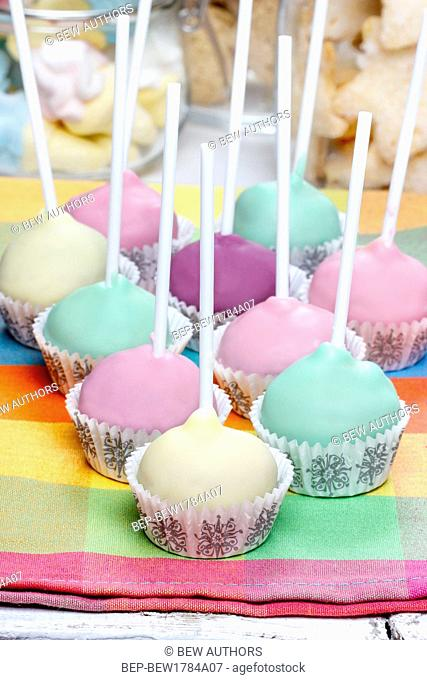 Colorful cake pops on checked napkin, birthday party