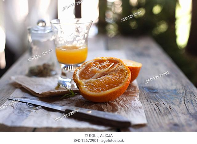 Sliced orange and orange juice on a wooden table